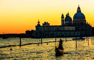 Venice, Italy - March 18, 2015: Gondola on Canal Grande with Basilica di Santa Maria della Salute in the background